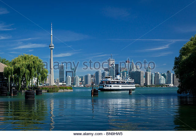 Skyline and island ferry approaching Centre Island in Toronto Island Park in Toronto Ontario Canada - Stock Image