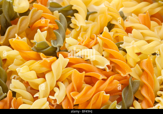 Multicolored pasta with the addition of natural tomatoes and spinach - Stock-Bilder
