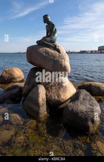 The Little Mermaid at Langelinie promenade in Copenhagen, Denmark. Based on the fairy tale by Hans Christian Andersen, - Stock Image
