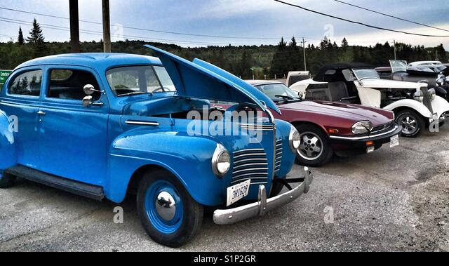 A gathering of old nostalgic cars. - Stock Image