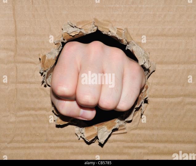 Fist breaking through - Stock Image