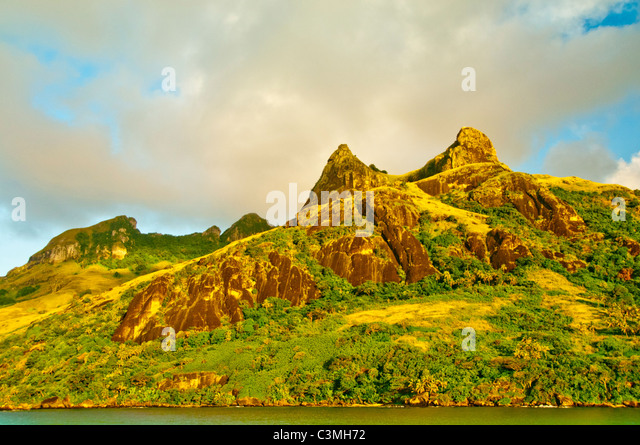 Evening light sets on the mountains of the Yasawa Islands aglow, Fiji - Stock Image