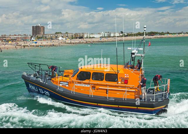 RNLI Shannon class lifeboat entering Littlehampton along the river Arun. - Stock Image