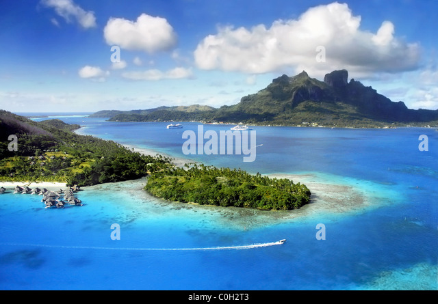 Aerial View of Bora Bora with Mount Otemanu in background and coral reef. - Stock Image