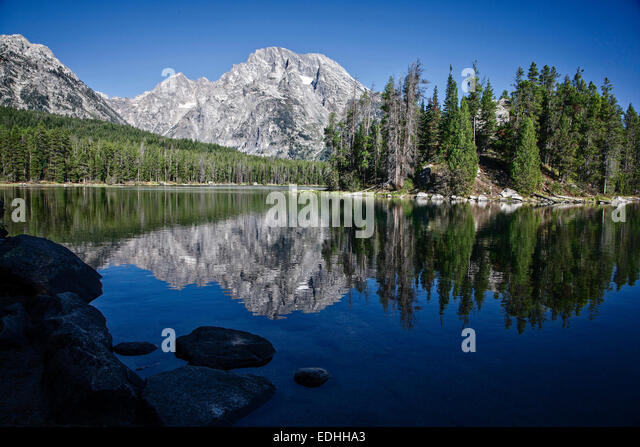 Mount Moran reflects in Leigh Lake in Grand Teton National Park. Wyoming. - Stock Image