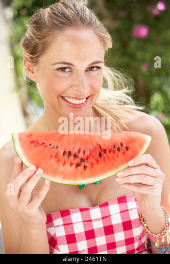 Couple Enjoying Slices Of Water Melon - Stock Image