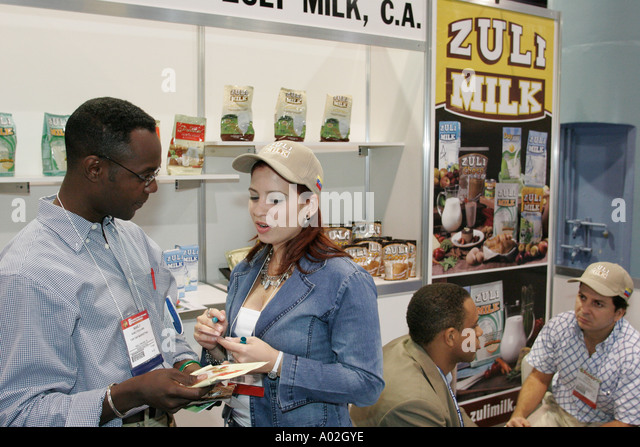Miami Beach Florida Convention Center Americas Food and Beverage Show Venezuela Zuli Milk Black male buyer - Stock Image