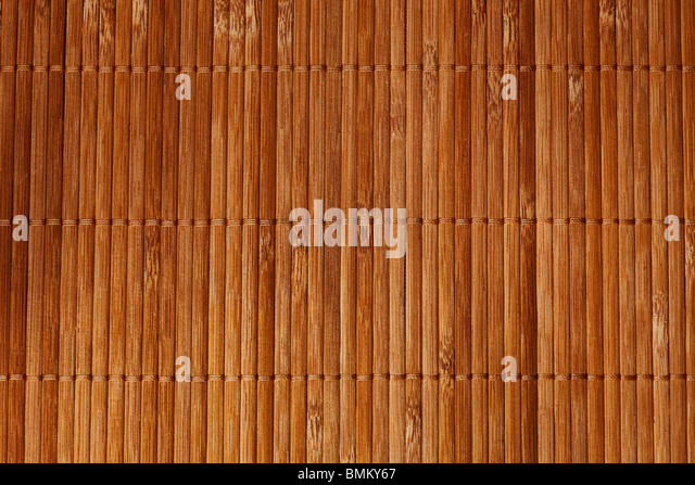 natural bamboo slatted mat background in brown tones - Stock-Bilder