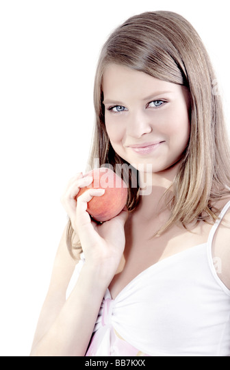Young girl with peach - Stock Image