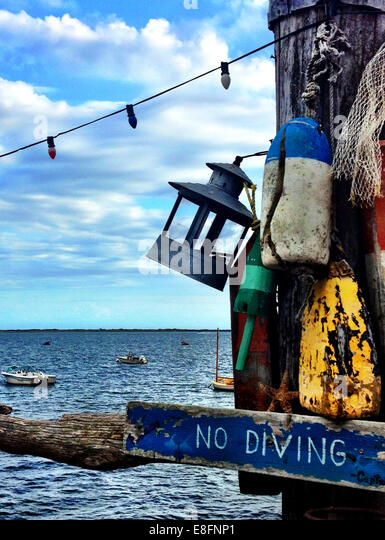 USA, Massachusetts, Provincetown, Wharf with view of horizon over water - Stock Image
