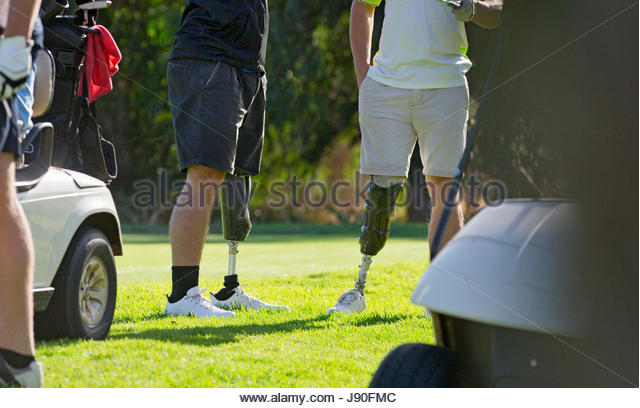 Close Up Of Male Golfers With Artificial Legs Standing By Green - Stock-Bilder