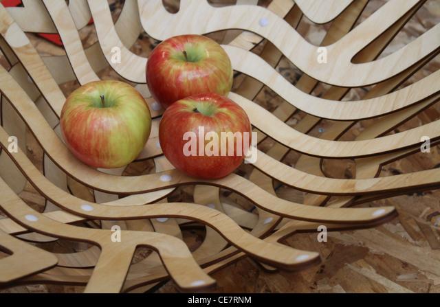 modern artistic wooden fruit apple tray - Stock-Bilder