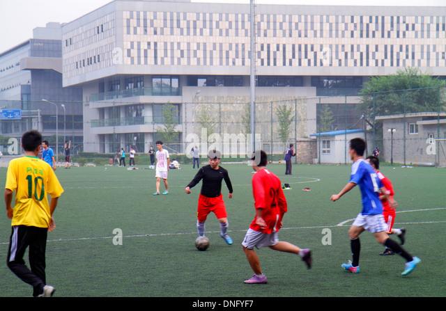 Beijing China Haidian District Peking University PKU Beidà higher education campus Asian man student friends - Stock Image