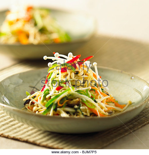 Vegetable stir-fry with enokitake mushrooms - Stock Image