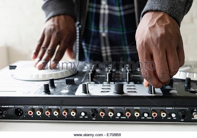 DJ using mixing desk, close up - Stock Image