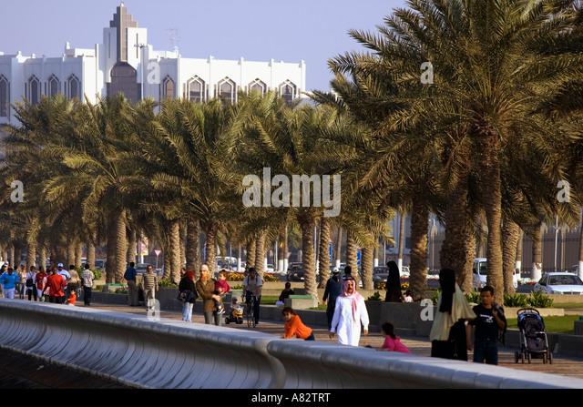 Qatar Doha corniche promenade people - Stock Image