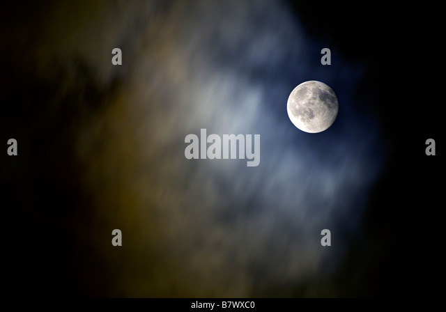 MOON SHOT  IN A CLOUDY NIGHT SKY - Stock Image