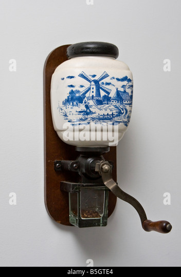 Original authentic nostalgic Delfts blue Dutch coffee mill isolated on white - Stock-Bilder