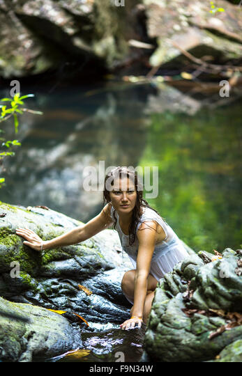 Woman Bathing In Waterfall Stock Photos & Woman Bathing In ...
