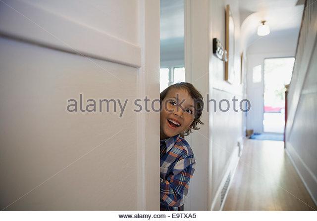 Excited boy in doorway - Stock Image