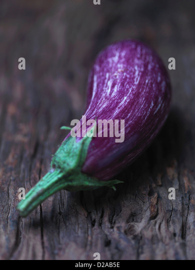 Aubergine on wooden counter - Stock Image