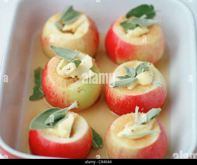 Apples stuffed with butter, sugar, sage - Stock Image