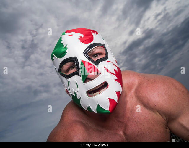 Large male muscular Wrestler with Mexican flag wrestling mask - Stock Image