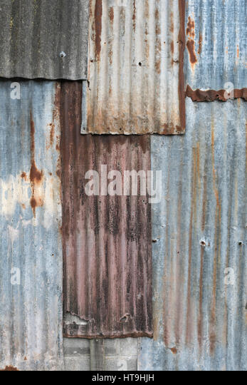 Overlaid sections of rusting galvanised / galvanized steel sheet, - Stock Image