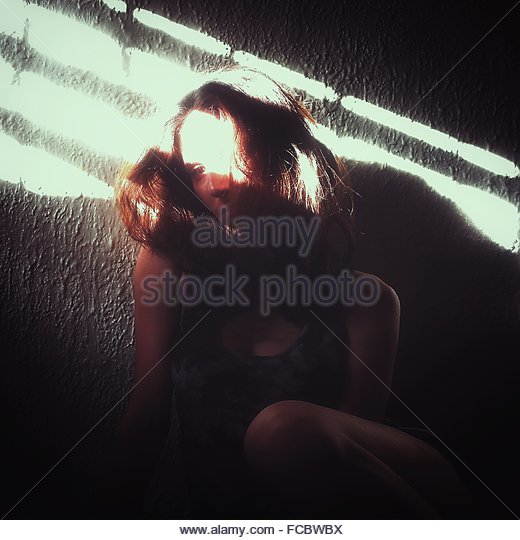 Sunlight Falling On Depressed Woman At Home - Stock Image
