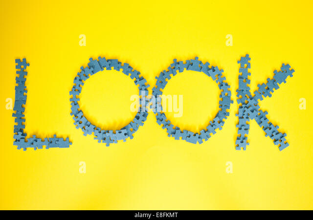 Blue Jigsaw Pieces Spelling Out Look - Stock Image