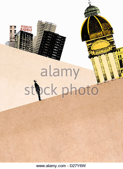 Businessman looking up at tilted bank building - Stock Image