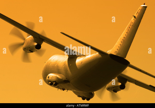Propeller airplane rear view from below - Stock Image