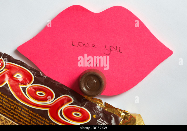 love you - the last rolo - Love you xx written on pink lips post it note with the last rolo of the packet set on - Stock Image
