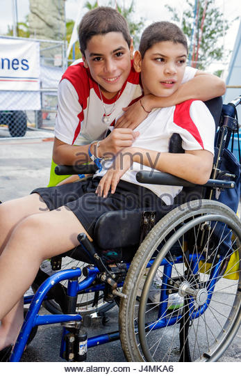 Miami Coconut Grove Florida Shake-a-Leg Miami No Barriers Festival disabled physical disability handicapped brothers - Stock Image