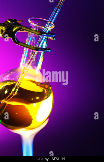 A flask of chemical fluid being heated - Stock Image