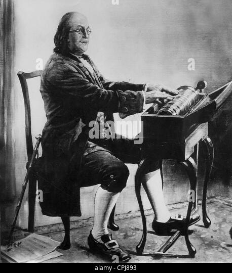Benjamin Franklin with a glass harmonica - Stock Image