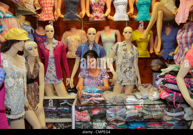 Peru Tacna Avenida San Martin commercial district retail store shopping boutique business clothing apparel mannequin - Stock Image