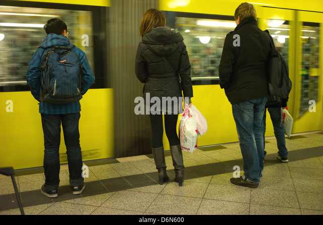 Berlin, Germany, Passengers on the platform of the incoming U2 at Alexanderplatz - Stock Image