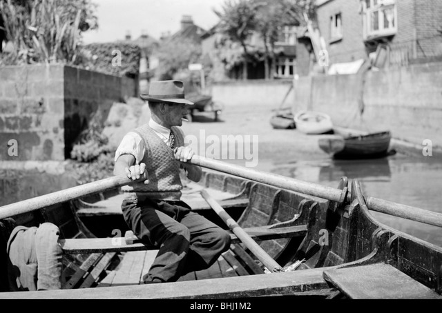 Man rowing the Twickenham ferry boat, Twickenham, c1945-c1965. Artist: SW Rawlings - Stock Image