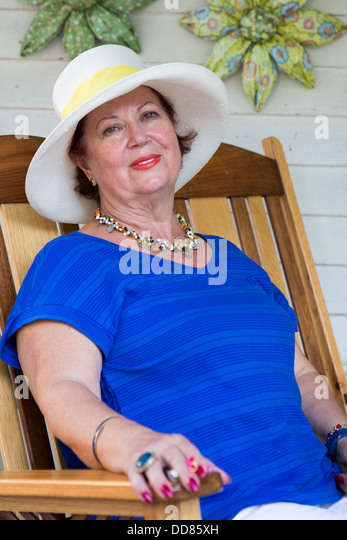 Senior Woman Relaxed on the Chair - Stock Image