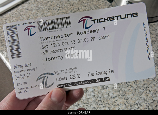 Person holding Johnny Marr Concert Ticket Manchester 2013 - Stock Image