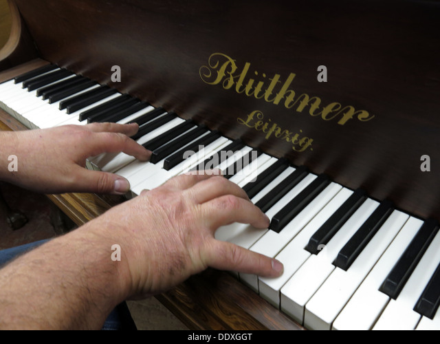 Playing a Bluthner Piano,Liepzig,Germany - Stock Image