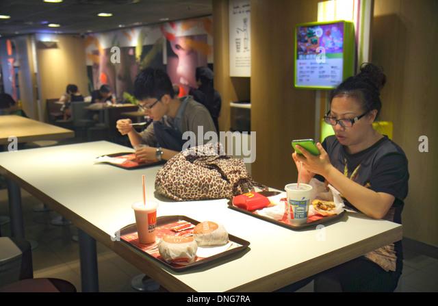 Hong Kong China Island Fortress Hill King's Road McDonald's fast food restaurant inside interior dining - Stock Image