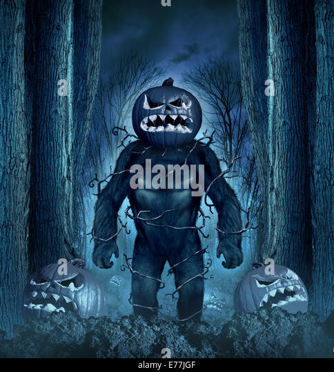 Halloween evil monster concept as a creepy creature with a scary pumkin head in a spooky night forest graveyard - Stock-Bilder