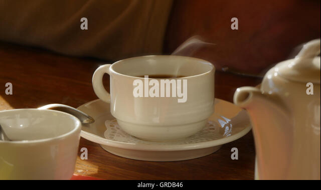 Pot Of Coffee, Cup Of Hot Steaming Coffee - Stock Image