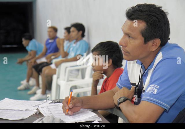 Panama Panama City Calidonia volleyball scorekeeper gymnasium sport athletics Hispanic man boy spectator - Stock Image