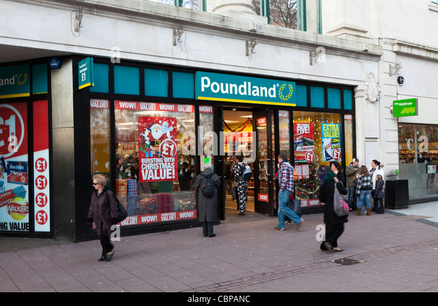 Poundland shop front with cheap goods on sale during Christmas period Cardiff Wales UK - Stock Image
