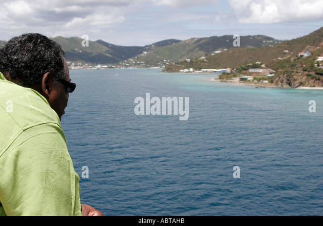 BVI Tortola Holland America Caribbean cruise ms Noordam Black male watching Observation Deck - Stock Image