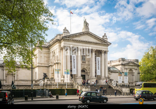 Banners for the Hockney exhibition outside Tate Britain viewed from Millbank, London, UK - Stock Image