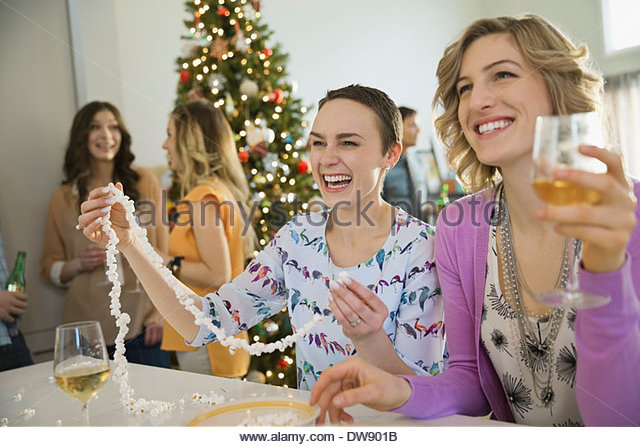 Friends spending leisure time together during Christmas - Stock Image